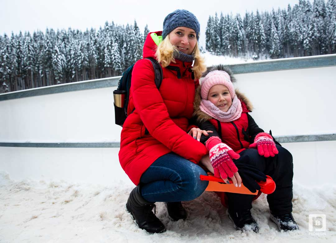 a mother with her daughter in bukovel winter trip 2019